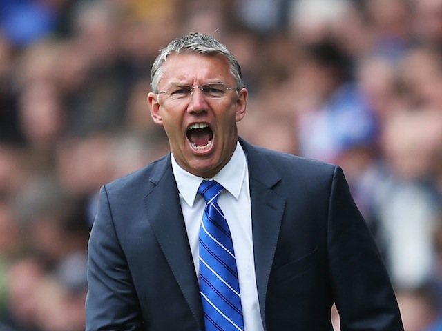 Nigel Adkins, manager of Reading, shouts instructions from the touchline on April 28, 2013