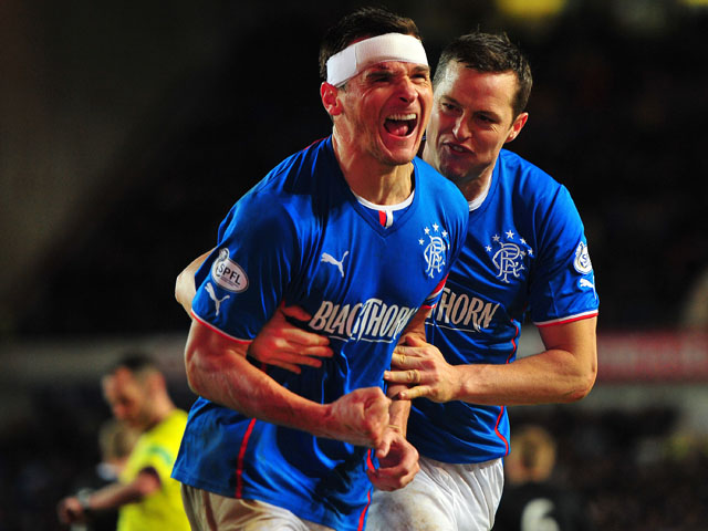 Lee McCulloch of Rangers celebrates with his team-mates after scoring the opening goal from the penalty spot during the Scottish League One match between Rangers and Dunfermline at Ibrox Stadium on November 6, 2013