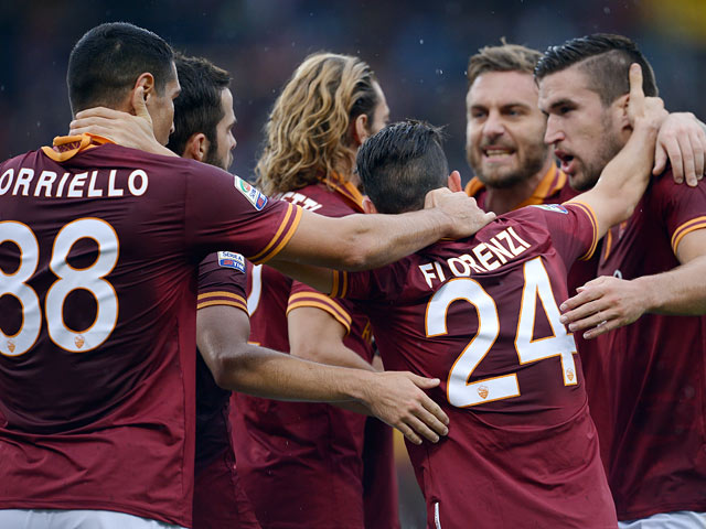 Roma players celebrates after going a goal up against Sassuolo on November 10, 2013