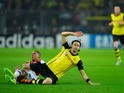 Dortmund's Serbian defender Neven Subotic and Arsenal's English defender Kieran Gibbs vie for the ball during the UEFA Champions League group F football match Borussia Dortmund vs Arsenal London in Dortmund, western Germany on November 6, 2013