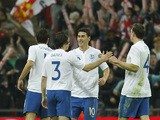 England's Gareth Barry celebrates with teammates after scoring a goal during the friendly football match between England and Sweden at the Wembley Stadium in London, on November 15, 2011