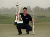 Henrik Stenson of Sweden poses with the Race To Dubai trophy and the DP World Tour Championship trophy after winning the latter on November 17, 2013