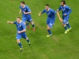Ignazio Abate of Italy celebrates with team-mates after scoring his team's first goal during the International Friendly match between Italy and Germany at San Siro Stadium on November 15, 2013