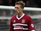 Luke Norris of Northampton Town in action during the Sky Bet League Two match between Northampton Town and Cheltenham Town at Sixfields Stadium on October 26, 2013