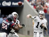 Matt McGloin of the Oakland Raiders completes a pass against the Houston Texans on November 17, 2013