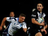 Shaun Johnson of New Zealand runs in to score a try during the Rugby League World Cup Quarter Final match between New Zealand and Scotland at Headingley Stadium on November 15, 2013