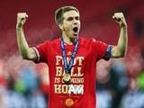 Bayern Munich captain Philipp Lahm celebrates winning the Champions League at Wembley Stadium on May 25, 2013