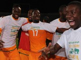 Serge Aurier of Ivory Coast celebrates qualification with team mates after the FIFA 2014 World Cup Qualifier Play-off Second Leg between Senegal and Ivory Coast on November 16, 2013