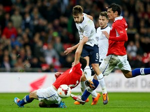 Adam Lallana of England shoots for goal during the international friendly match between England and Chile at Wembley Stadium on November 15, 2013