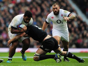 Sam Whitelock of New Zealand tackles Billy Vunipola of England during the QBE International match between England and New Zealand at Twickenham Stadium on November 16, 2013
