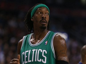Gerald Wallace #45 of the Boston Celtics stands on the court against the Toronto Raptors during their NBA game at the Air Canada Centre on October 30, 2013
