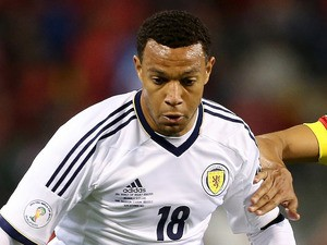 Matty Phillips of Scotland in action with Nacer Chadli of Belgium during the FIFA 2012 World Cup Qualifier match between Belgium and Scotland on October 16, 2012