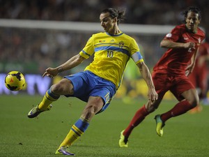 Sweden's forward Zlatan Ibrahimovic kicks the ball next to Portugal's defender Bruno Alves during the FIFA 2014 World Cup qualifier play-off first leg football match Portugal vs Sweden at the Luz stadium in Lisbon on November 15, 2013