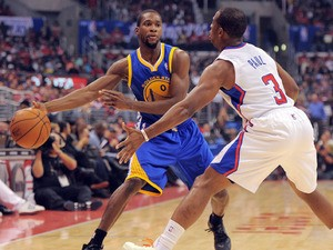 Clippers' Chris Paul blocks Warriors' Toney Douglas during NBA game between Golden State Warriors and Los Angeles Clippers at Staples Center on October 31, 2013