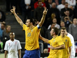 Sweden's striker and team captain Zlatan Ibrahimovic celebrates with his teammates after scoring his 3rd goal of the match during the FIFA World Cup 2014 friendly match England vs Sweden in Stockholm, on November 14, 2012