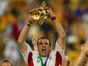 England captain Martin Johnson celebrates with the Webb Ellis trophy after beating Australia in the World Cup final on November 22, 2003