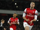Arsenal's French striker Olivier Giroud celebrates scoring his second goal from the penalty spot during the English Premier League football match between Arsenal and Southampton at the Emirates Stadium in London on November 23, 2013