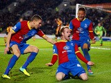 Barry Bannan of Crystal Palace celebrates scoring the opening goal with team mates during the Barclays Premier League match between Hull City on November 23, 2013