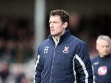 Lincoln City manager Chris Sutton looks on during the Coca Cola League Two Match between Lincoln City and Northampton Town at Sincil Bank Stadium on March 27, 2010