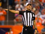 Referee Clete Blakeman makes a call during a game between the St. Louis Rams and Denver Broncos at Sports Authority Field at Mile High on August 24, 2013