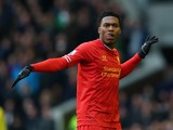 Daniel Sturridge of Liverpool celebrates scoring his team's third goal during the Barclays Premier League match between Everton and Liverpool at Goodison Park on November 23, 2013
