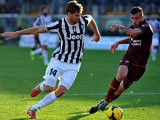 Juventus' Fernando Llorente and Livorno's Federico Ceccherini battle for the ball during their Serie A match on November 24, 2013
