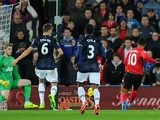 Cardiff's Fraizer Campbell scores his team's opening goal and equaliser against Manchester United during their Premier League match on November 24, 2013
