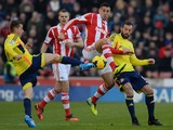 Stoke City's defender Geoff Cameron vies with Sunderland forward Steven Fletcher and midfielder Emanuele Giaccherini during a game on November 23, 2013