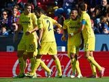 Villarreal 's Ikechukwu Uche celebrates with teammates after scoring his team's third goal against Levante on November 24, 2013