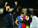 Keith Millen, caretaker manager of Crystal Palace celebrates victory after the Barclays Premier League match between Hull City and Crystal Palace at KC Stadium on November 23, 2013