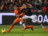 Netherlands' Memphis Depay and Columbia's Santiago Arias battle for the ball during their international friendly match on November 19, 2013