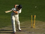 Mitchell Johnson of Australia is bowled by Stuart Broad of England during day one of the First Ashes Test match on November 21, 2013