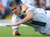 Scott Wooton of Leeds United challenges Andrew Shinnie of Birmingham City during their Sky Bet Championship match between Leeds United and Birmingham City on October 20, 2013