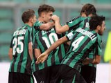 Sassuolo's Simone Zaza is congratulated by teammates after scoring his team's opening goal against Atalanta on November 24, 2013