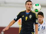 Sweden's Valmir Berisha controls the ball ahead of Honduras' captain Luis Santos (R) during their FIFA U-17 World Cup UAE 2013 football match at Al Ain City on November 1, 2013
