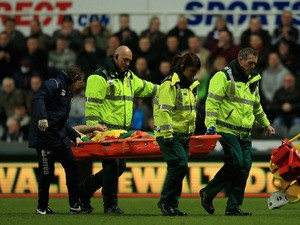 Anthony Pilkington of Norwich is stretchered off during the Barclay's Premier League match against Newcastle United on November 23, 2013