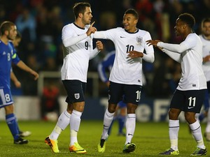 England's Danny Ings is congratulated by teammates after scoring his team's third goal against San Marino during their U21 Euro 2015 qualifying match on November 19, 2013