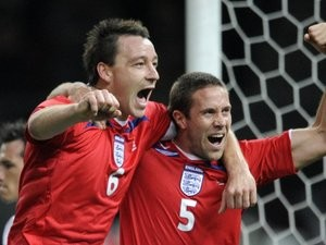 England's John Terry and Matthew Upson celebrate the latter's goal against Germany on November 19, 2008.