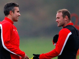 Wayne Rooney and Robin van Persie of Manchester United talk during a training session ahead of their Champions League Group A match against Shakhtar Donetsk at their Carrington Training Complex on October 01, 2013