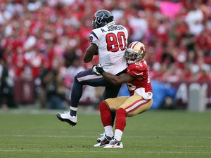 Wide receiver Andre Johnson #80 of the Houston Texans is brought down by cornerback Tarell Brown #25 of the San Francisco 49ers at Candlestick Park on October 6, 2013