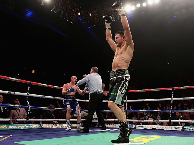 Carl Froch celebrates victory over George Groves as the referee stops the fight in the ninth round during their IBF & WBA World Super Middleweight Title fight on November 23, 2013