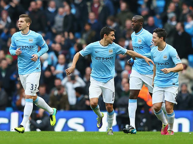 Man City's Jesus Navas celebrates with teammates after scoring the opening goal against Tottenham on November 24, 2013