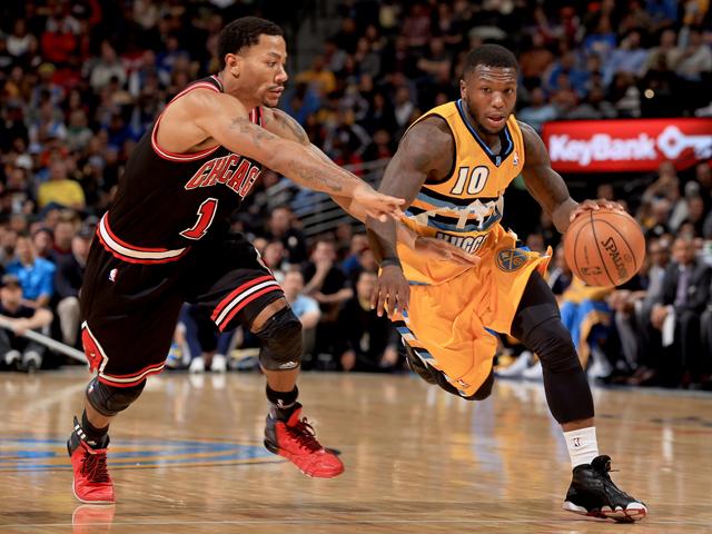 Derrick Rose #1 od the Chicago Bulls guards Nate Robinson #10 of the Denver Nuggets at Pepsi Center on November 21, 2013