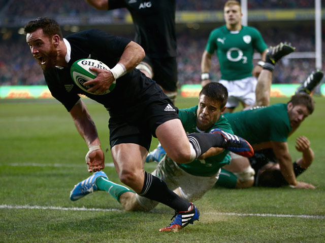 New Zealand's Ryan Crotty scores the winning try against Ireland during their international match on November 24, 2013