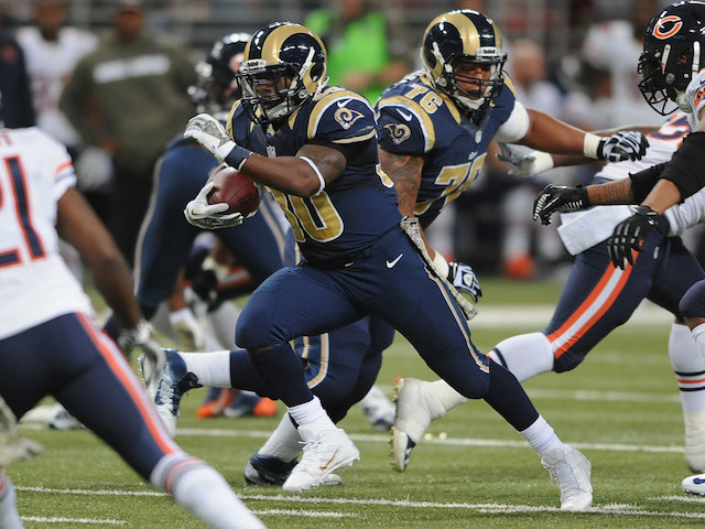 Zac Stacy of the St. Louis Rams rushes against the Chicago Bears in the second quarter at the Edward Jones Dome on November 24, 2013