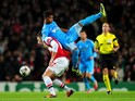 Mario Lemina of Marseille climbs on Olivier Giroud of Arsenal during the UEFA Champions League Group F match between Arsenal and Olympique de Marseille at Emirates Stadium on November 26, 2013