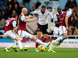 Adel Taarabt of Fulham is tracked by Mark Noble, James Collins, Guy Demel and James Tomkins of West Ham United during the Barclays Premier League match on November 30, 2013