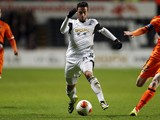 Swansea City's Spanish striker Alvaro Vazquez vies for the ball against Valencia during the Group A Europa League football match between Swansea and Valencia CF at The Liberty Stadium in Swansea on November 28, 2013
