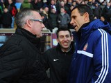 Aston Villa manager Paul Lambert greets Sunderland manager Gus Poyet before the start of the Barclays Premier League match between Aston Villa and Sunderland at Villa Park on November 30, 2013