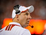 Nebraska Cornhuskers head coach Bo Pelini eyes the clock as his offense runs out the remaining minutes of their game against the Southern Miss Golden Eagles at Memorial Stadium on September 7, 2013